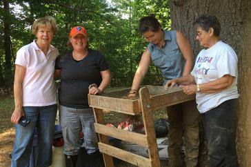 Meghan Howey with three volunteers at dig site