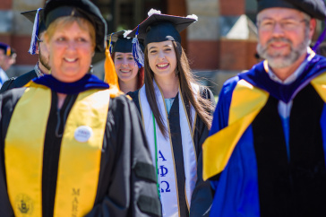 UNH graduate Jessica Nadeau '18 and UNH faculty members during ceremony
