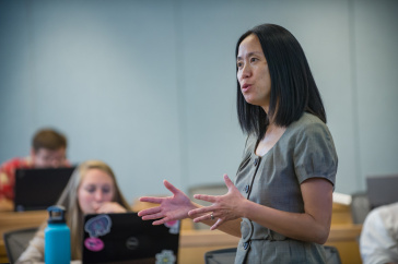 Jing Wang teaches students in a class