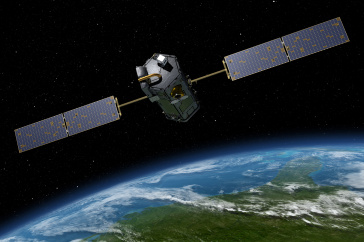 Artist's rendering of a satellite in space above Earth.