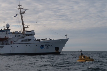 Photo of the ship from a voyage that deployed the first autonomous (robotic) surface vessel — the Bathymetric Explorer and Navigator (BEN) — far above the Arctic Circle.