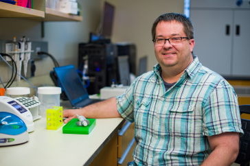 Researcher Matt MacManes seated in his lab