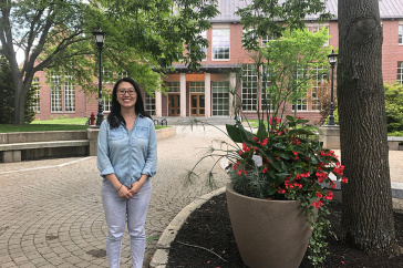 photo of Sasa Tang in front of Library