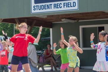 A UNH student coaching a youth program