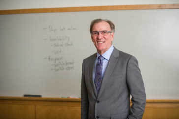 Marketing professor Tom Gruen poses in front of a white board