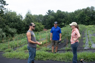 Dan Birhstihl '178with Extension field specialists Jeremy DeLisle and Elaina Enzien.