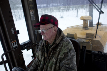 Image of Retiree Plowing Snow. Photo Credit: CityLab