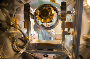 Student works on vacuum chamber in UNH's Space Science Center.