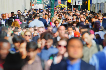 People of different backgrounds walking on an extremely crowded sidewalk