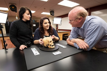 Katie Titus in archaelogy lab with Amy Michael and Greg McMahon