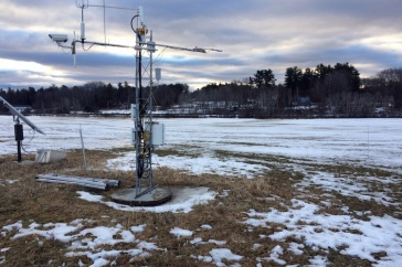 TOWER WITH AUTOMATED SENSORS AT KINGMAN FARM HAYFIELD IN WINTER.