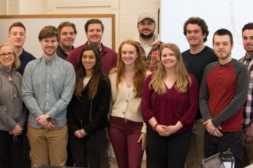 UNH students pose in classroom