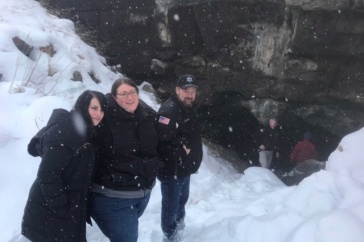 Anthropologist Amy Michael and law enforcement officers at the entrance to the cave where Joseph Henry Loveless's body was found