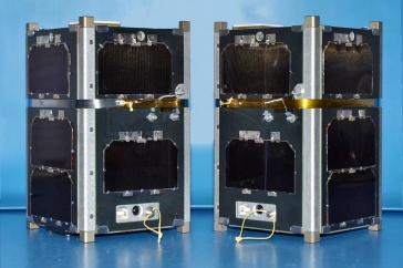 Two CubeSats designed by UNH researchers.