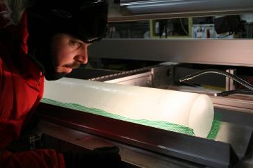Joe Souney inspects an ice core from Antarctica.