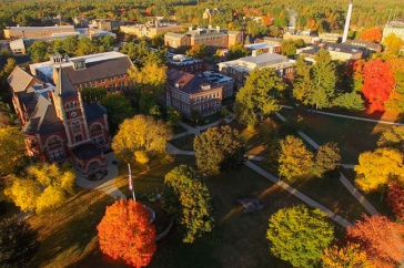 Drone shot of UNH campus with brilliant autumn colors