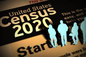 "A picture of the words ""Census 2020"" with cut out men and women standing to the right of it."