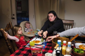 A NH Family Sits Down to Eat Dinner