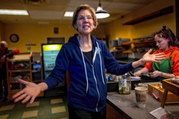 Elizabeth Warren stands in a NH coffee shop