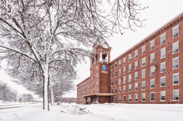 UNH Manchester campus covered in snow during winter