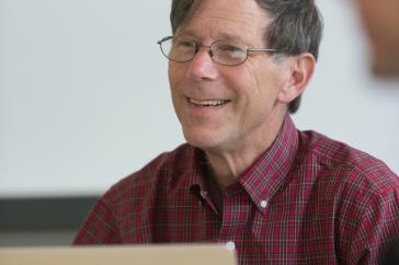 David Finkelhor works at a laptop