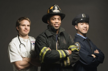 A photo of three first responders: An emergency medical technician, a firefighter, and a police officer