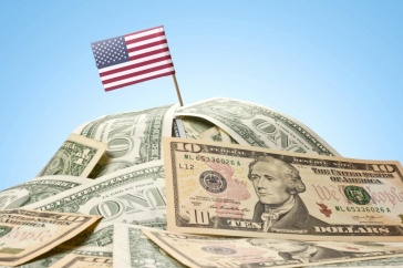 A graphic of an American flag on a pile of money.