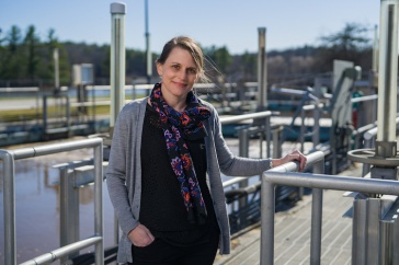 Paula Mouser stands on catwalk at Durham's wastewater treatment facility