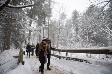 Students crossing bridge in winter