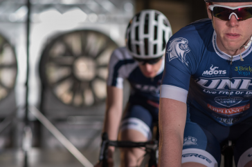UNH undergraduate researchers on bikes in the wind tunnel