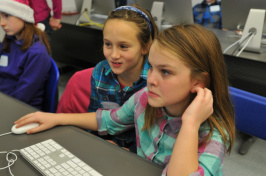 Students learning computer code