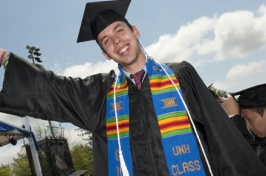 student in multicultural attire at commencement
