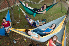 students relaxing in hammocks