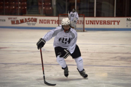 Julie Hird, 16, playing ice hockey