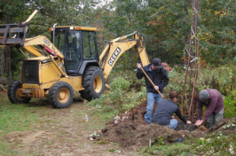 students landscaping with bulldozer assistance