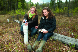 Ruth Varner and student working in the field