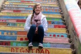 sarah wiggins sitting on colorful steps