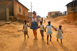 in Ghana, holding children's hands