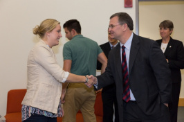 Tim Collins shaking hands with attendee