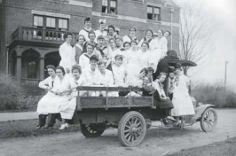 students loaded on truck in front of smith hall, around 1908