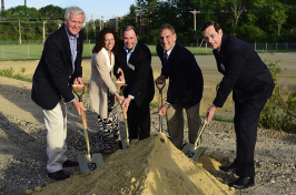 People with shovels at ground breaking
