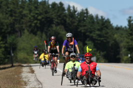 cyclists riding three notch century