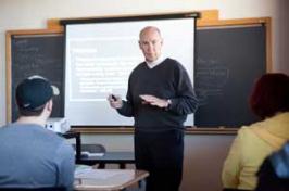 unh manchester history professor teaching a class