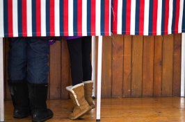 People stand in a booth while voting in the New Hampshire primary earlier this year (Photo by Keith Bedford, Globe Staff)