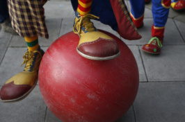 clown feet and a large red ball (Photo: Peter Nicholls / Reuters)