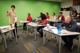Instructor Elizabeth Hogan leads a healthcare class at Jewish Vocational Service in Boston. (ROBIN LUBBOCK/WBUR)
