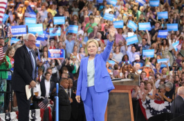 Hillary Clinton greets the crowd along with Senator Bernie Sanders during an event in which she was endorsed by Senator Sanders at Portsmouth High School on Tuesday, July 12, 2016 in Portsmouth, New Hampshire. (Bryce Vickmark/Zuma Press/TNS)