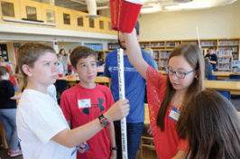 Sixth-graders from Pine Tree and Josiah Bartlett schools working together on a science project