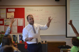 UNH alumnus Tate Aldrich teaches an English class at Laconia High School