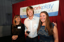 David Hutchings of Windham was presented with the 'Shire Story of the Year Video while flanked by Besty Gardella, left, of New Hampshire Public Radio, and Kate Luczko, president and CEO of Stay Work Play, at the Rising Stars awards sponsored by Stay Work Play New Hampshire hosted at Fieldhouse Sports in Bow on Monday. (Mark Bolton/Union Leader)